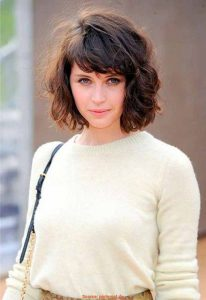A curly bob cut with bangs